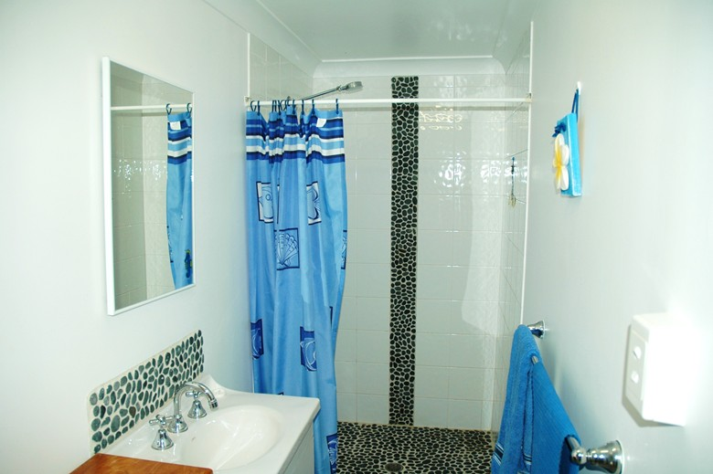 Bathroom at Copa Shells Beach House - A pet friendly holiday accommodation beach house with dog friendly beaches at Copacabana Beach on the Central Coast NSW